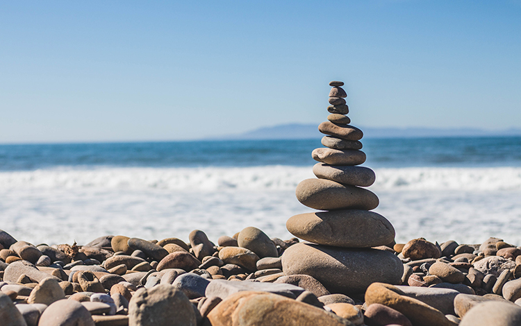 Balancing rocks on shore